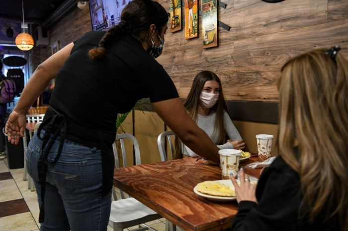 Photo for: Indoor dining opens up in New York today